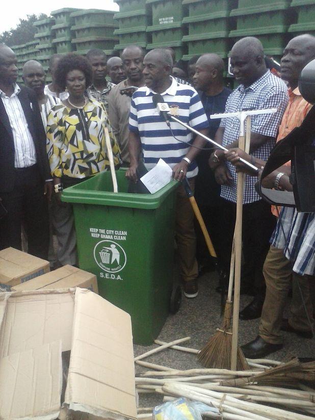 Alhaji Collins Dauda, Hon Eric Opoku and others unveiling sanitation logistics