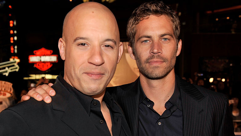 """UNIVERSAL CITY, CA - MARCH 12:  Actors Vin Diesel (L) and Paul Walker arrive at the premiere Universal's """"Fast & Furious"""" held at  Universal CityWalk Theaters on March 12, 2009 in Universal City, California.  (Photo by Kevin Winter/Getty Images)"""